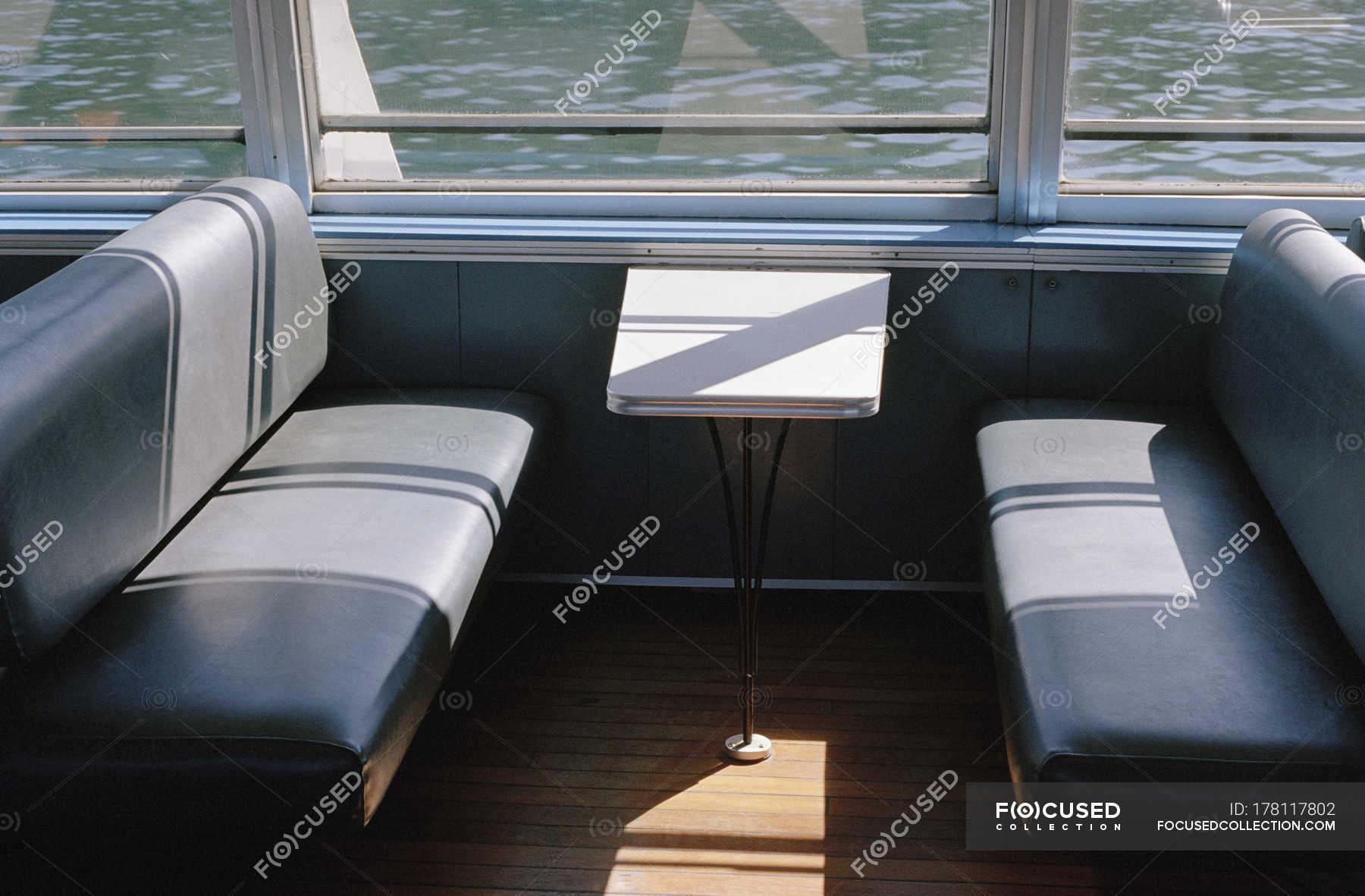 Empty bench seats inside ferry — nautical vessel, mode of