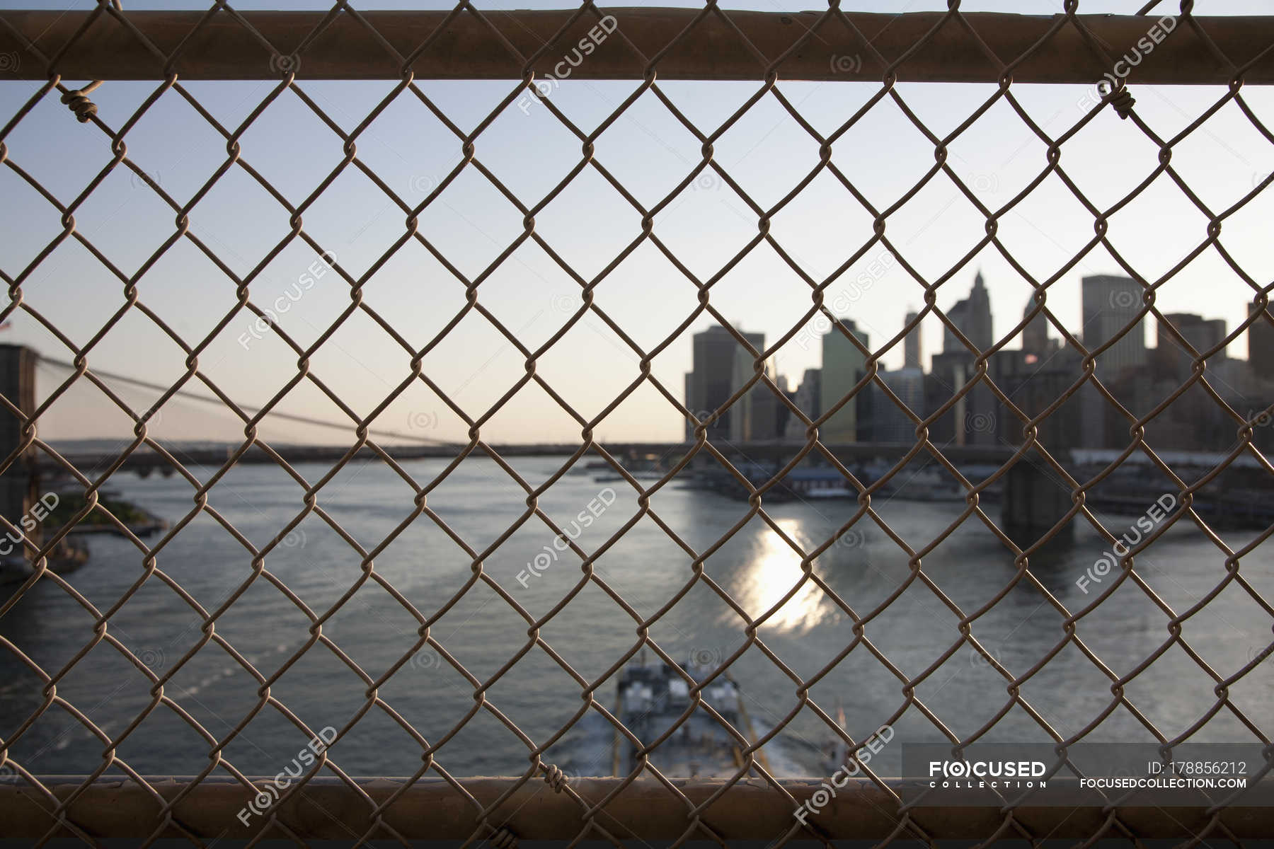 View through ridge wire mesh fence to boat skyscrapers — Stock Photo ...