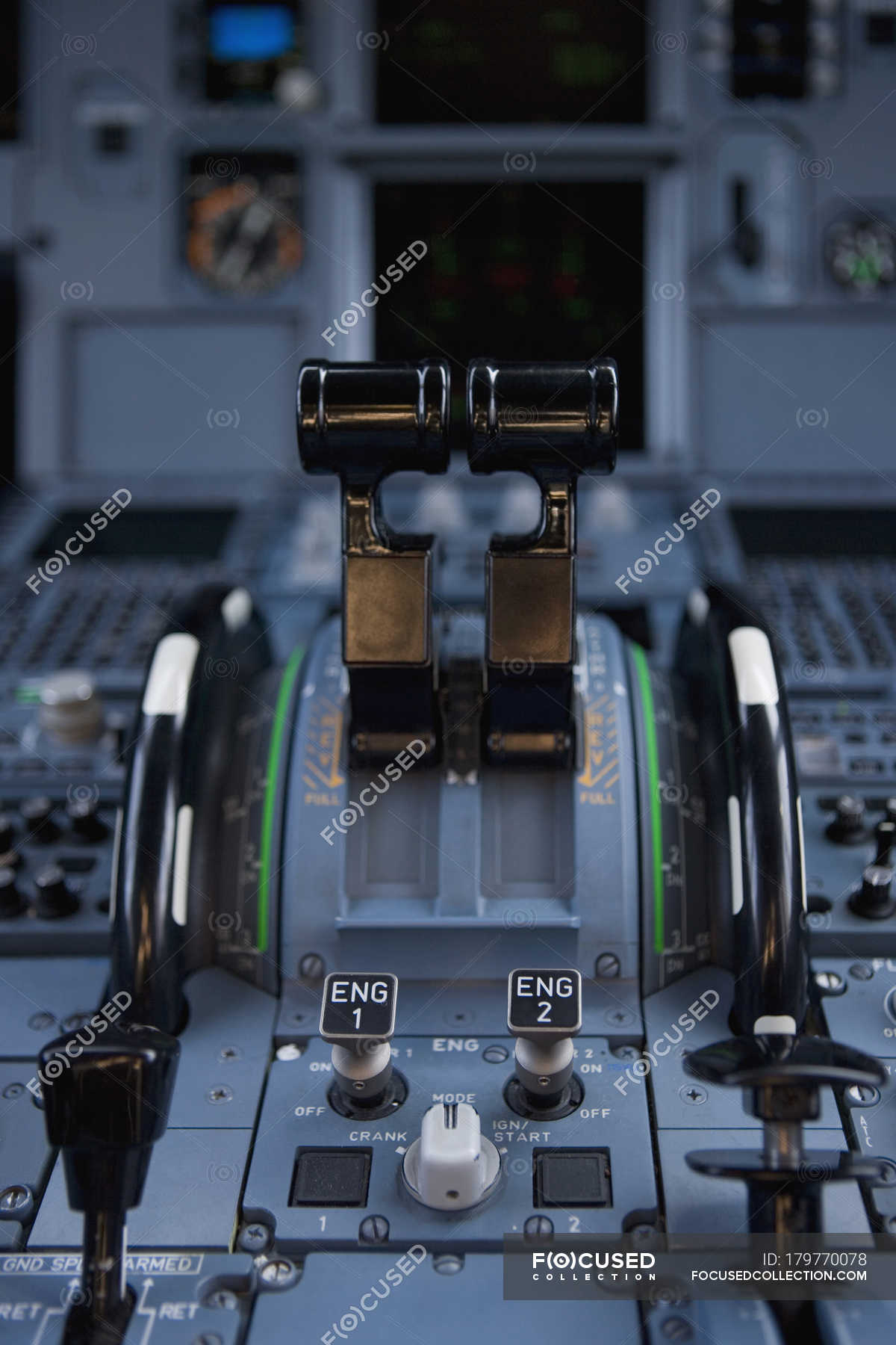 Close up view of levers at control panel of commercial airplane ...
