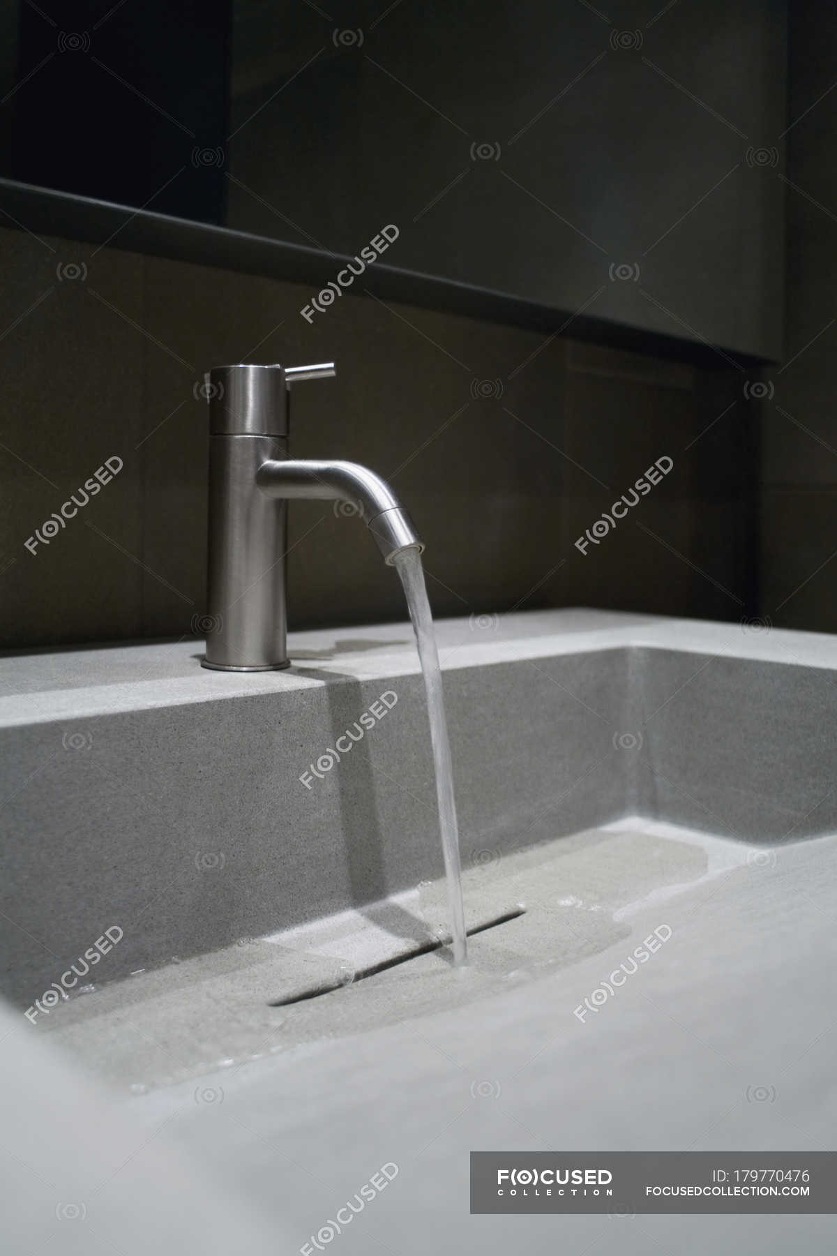 Close up view of faucet with running water — Stock Photo | #179770476
