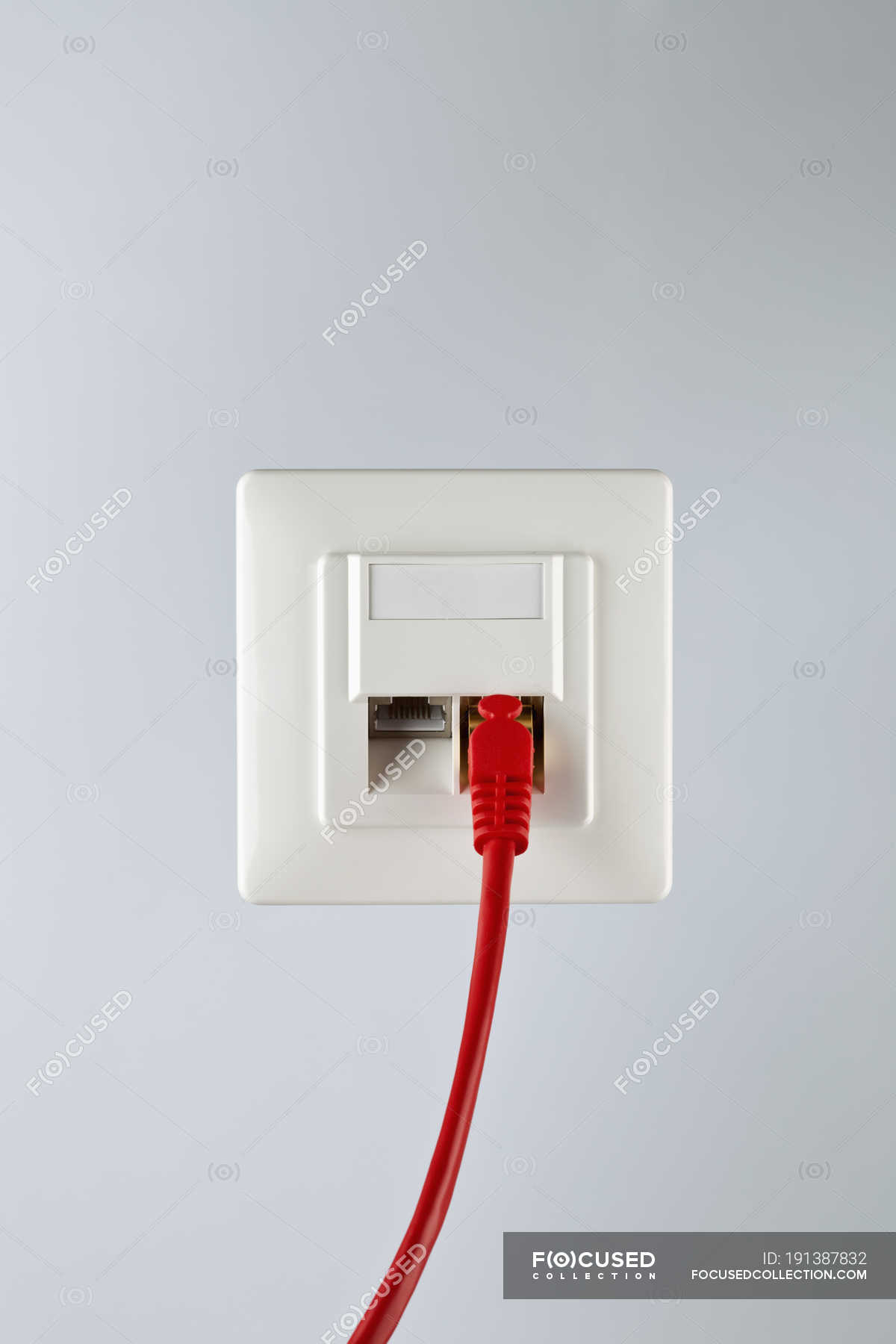 Red Network Cable Plugged Into Wall Socket Studio Shot Wiring Ethernet Plug Connection Stock Photo 191387832
