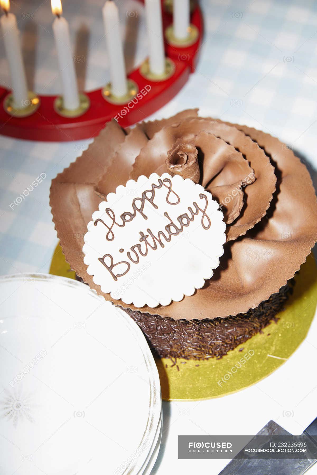 Chocolate Birthday Cake On Table Stock Photos