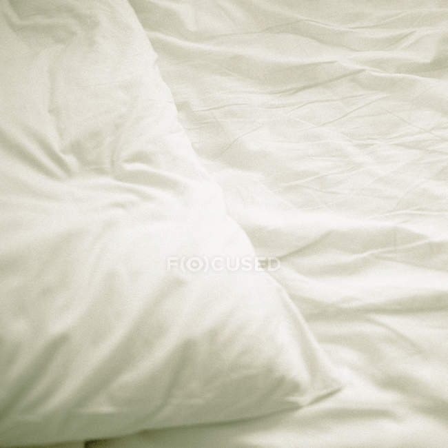 Close up view of white pillow on bed — Stock Photo