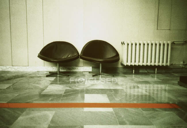 Two black chairs in waiting lounge — Stock Photo