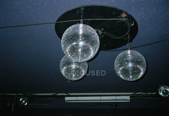 Three shiny disco balls on ceiling — Stock Photo