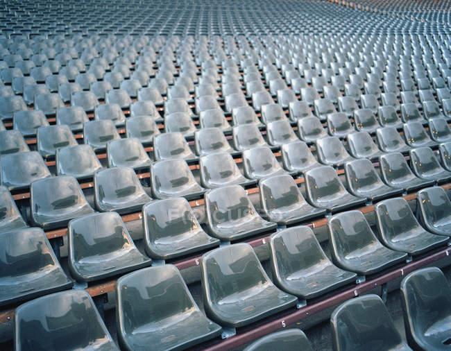 Perspective view of rows of plastic stadium seats — Stock Photo