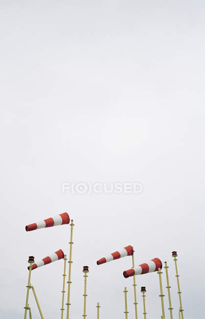 Red and white weather flags over grey sky — Stock Photo