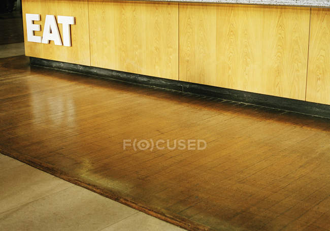 Interior view to corridor with eat inscription on counter — Stock Photo