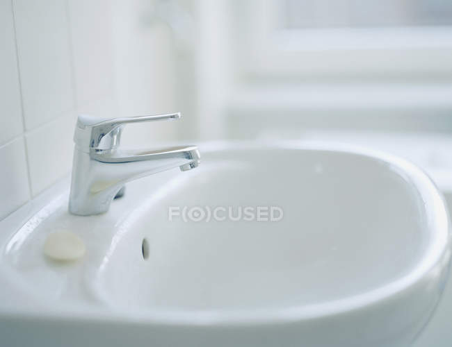 Close up view of bathroom sink with tap — Stock Photo