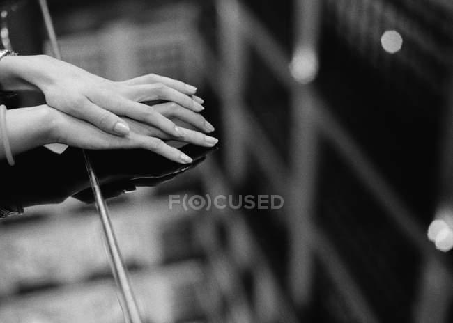 Crop female hands on piano desk — Stock Photo