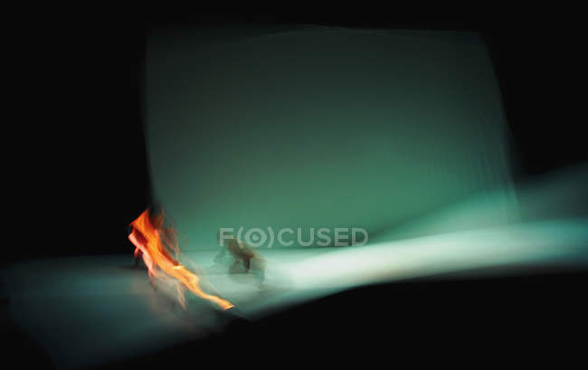 Abstract blur view of moving light dot on grey background — Stock Photo