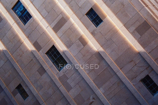 Tilt  perspective of building facade with windows — Stock Photo