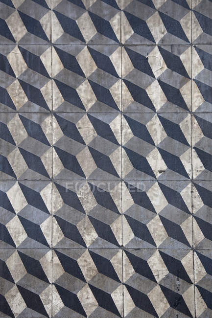 Abstract pattern of tiled concrete wall — Stock Photo