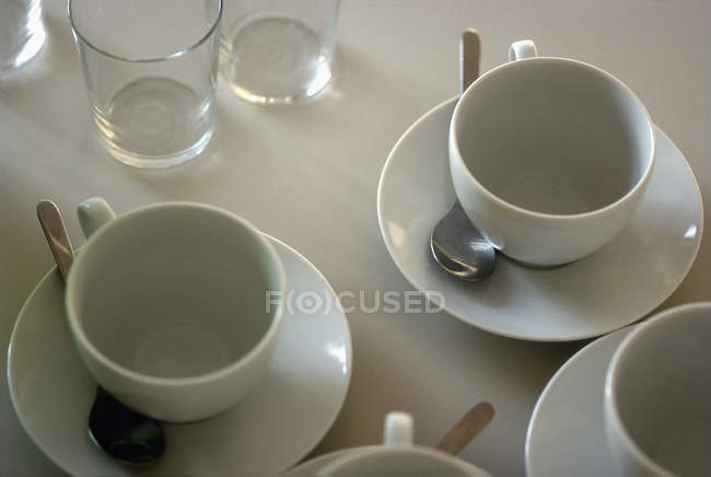 Top view of served empty ceramic cups and glasses — Stock Photo