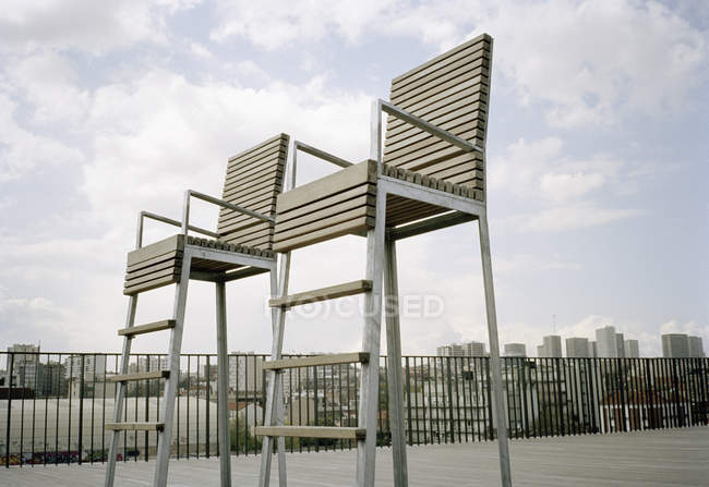 High angle view of two empty chairs on rooftop — Stock Photo