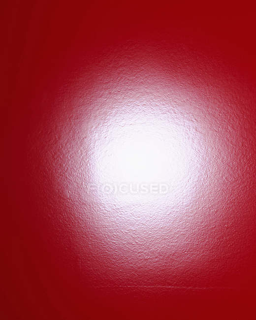Flashbulb reflection on red surface — Stock Photo