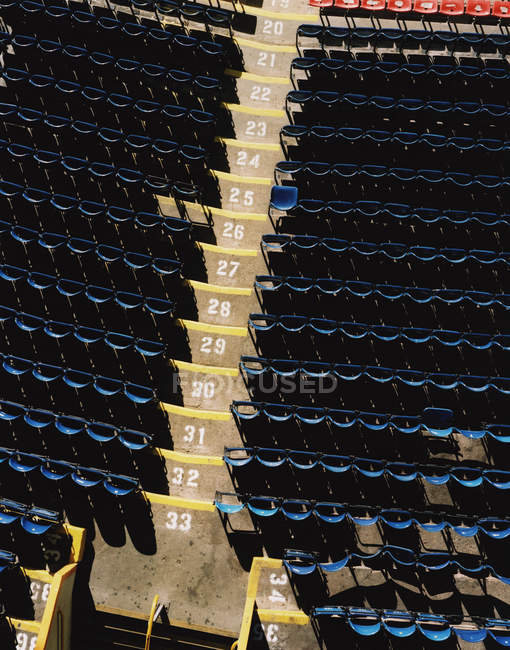 Top view of rows of empty seats at stadium terrace — Stock Photo