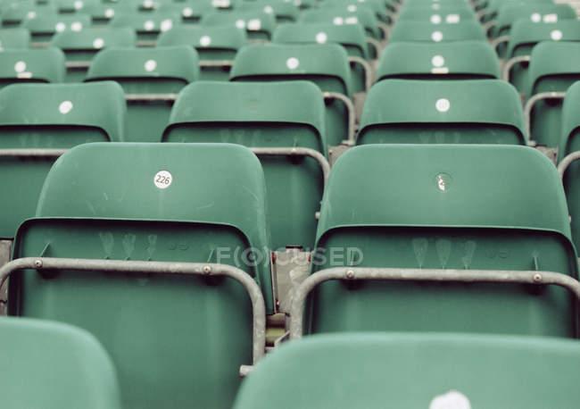 Rows of empty green stadium seats — Stock Photo