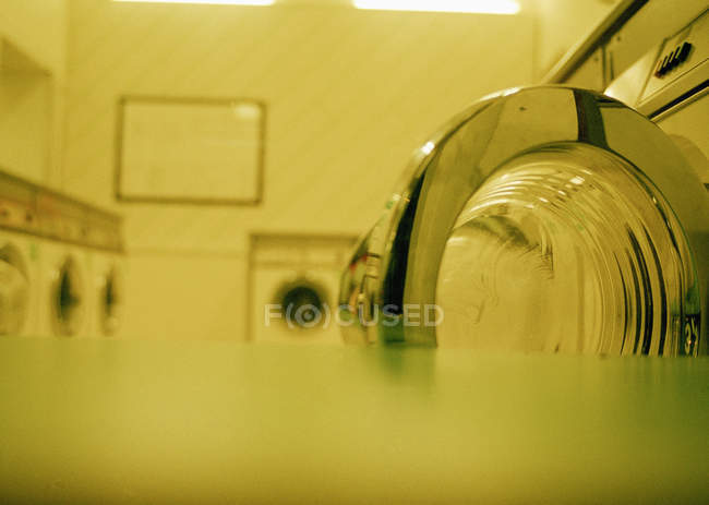 Close up view of rows of washing machine at a Laundromat — Stock Photo