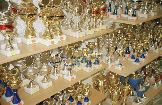Close up view of shelves at trophy shop — Stock Photo
