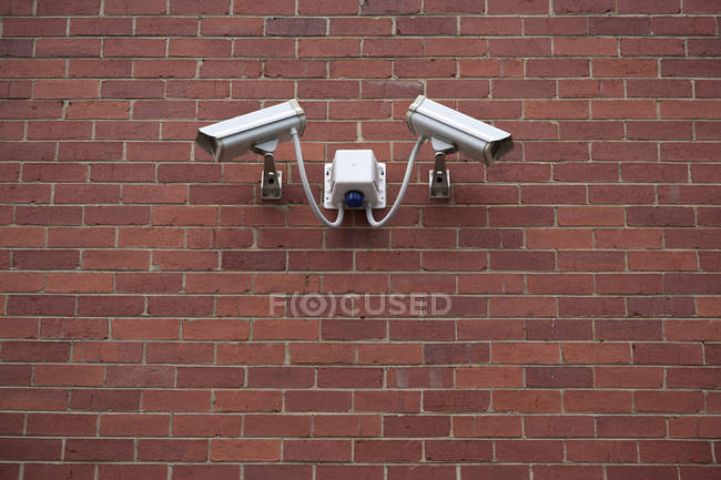 Video surveillance cameras on brick wall — Stock Photo