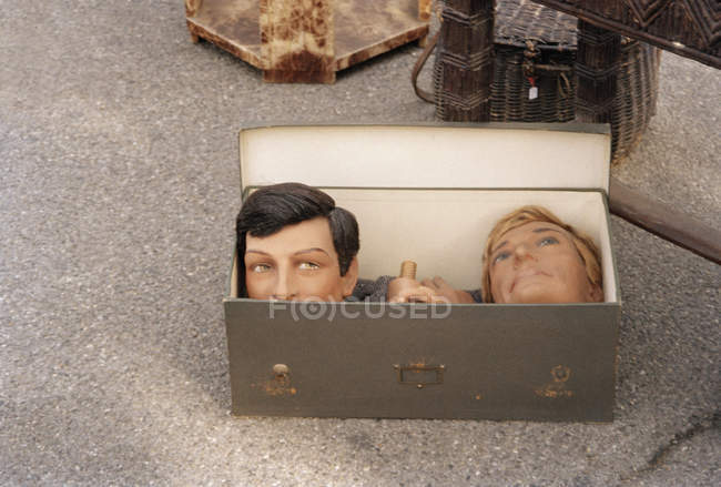 Close up view of two mannequin heads and hands in box — Stock Photo