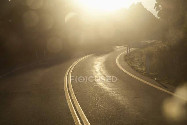 Sunlit curvy highway road at countryside — Stock Photo