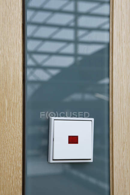 Light switch on glass reflecting a staircase — Stock Photo