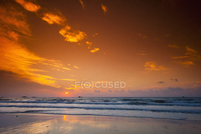 Scenic marine on background of orange sunset sky — Stock Photo