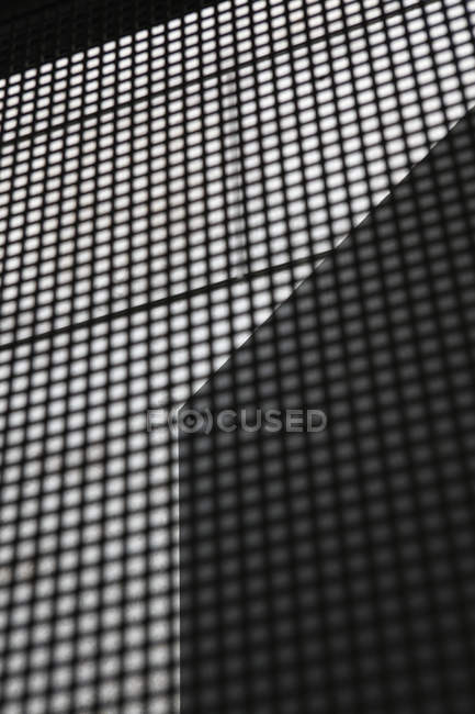 Geometrical shadow on grid patterns — Stock Photo