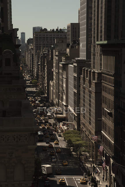 Low angle view of street traffic among skyscrapers — Stock Photo
