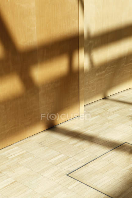 Window shadows on hardwood floor and wall — Stock Photo