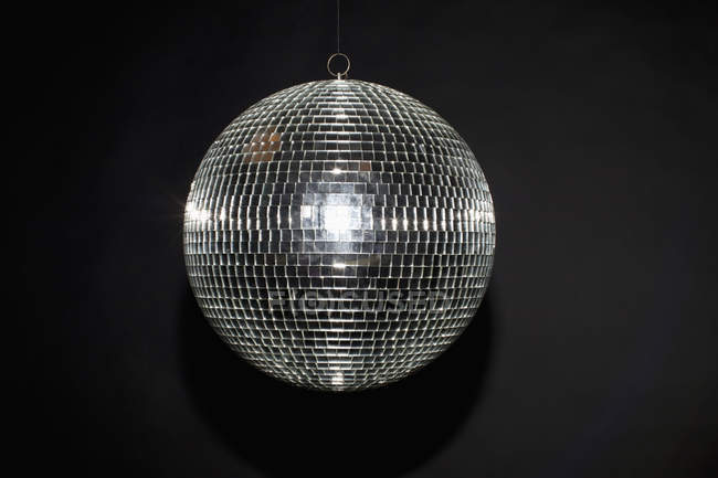 Close up view of shiny disco ball on black background — Stock Photo