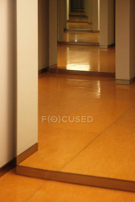 Perspective view of doorsteps on raising floor — Stock Photo
