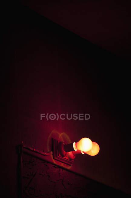 High angle view of bulbs illuminated on club wall — Stock Photo