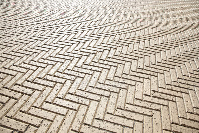Low angle view of tiled floor in zigzag pattern — Stock Photo