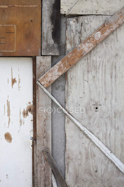 Close up view of pieces of wood used to board up  structure — Stock Photo