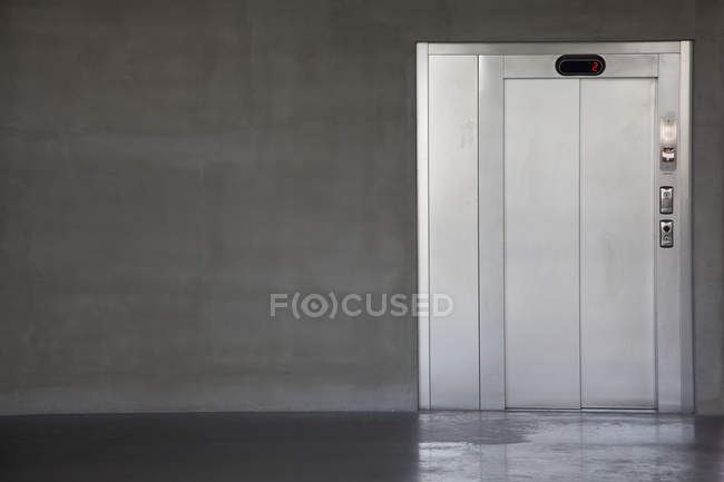 View of elevator door at corridor passage — Stock Photo