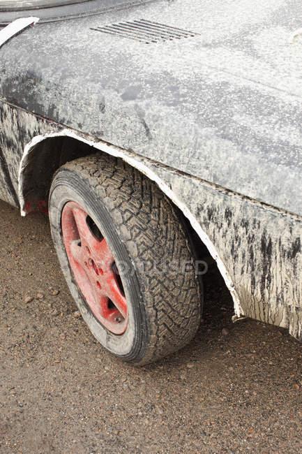 Crop muddy wheel of sport car. — Stock Photo