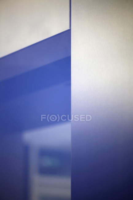 Blue light shining over elevator door — Stock Photo