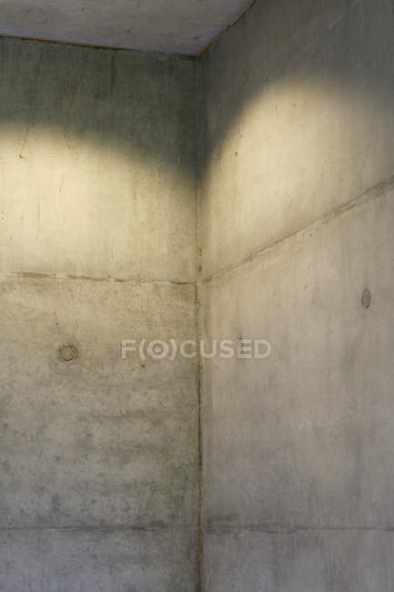 Corner of concrete wall indoors — Stock Photo