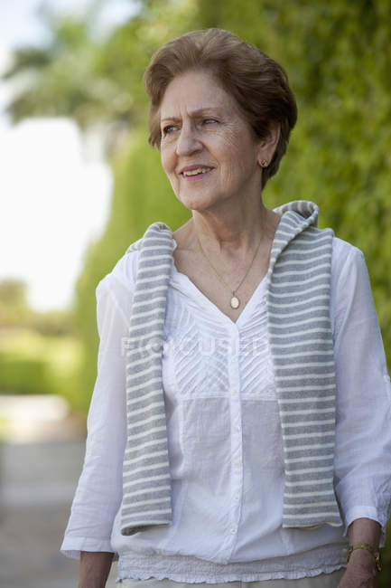 Portrait of senior woman looking away outdoors — Stock Photo