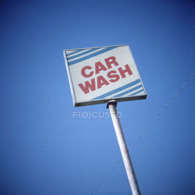 Car wash sign over bright sky — Stock Photo