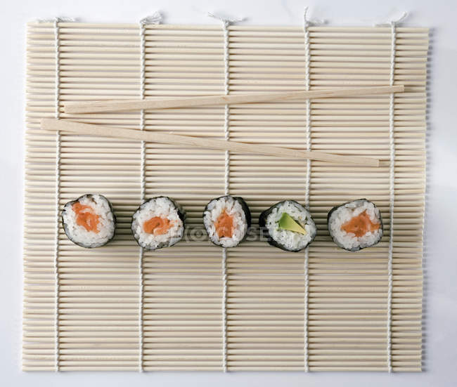 Directly Above View Of Sushi And Chopsticks On Bamboo Mat