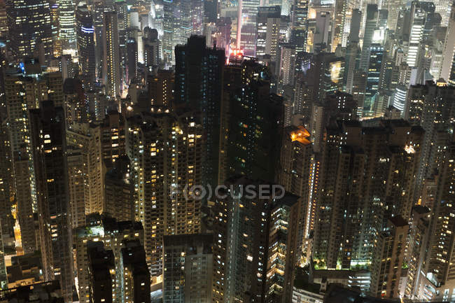 High angle view of skyscrapers facades with illuminated windows at night — Stock Photo