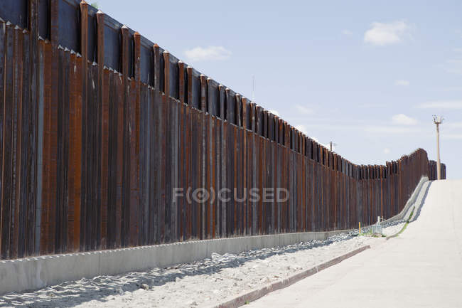 Barrier fence along road against sky — Stock Photo
