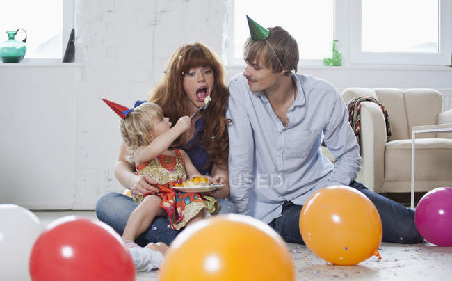 A young family celebrating a birthday — Stock Photo