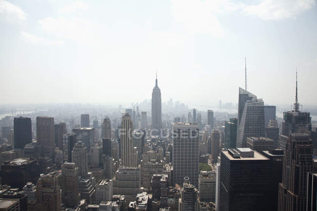 Midtown Manhattan cityscape with blue sky, New York City, USA — Stock Photo