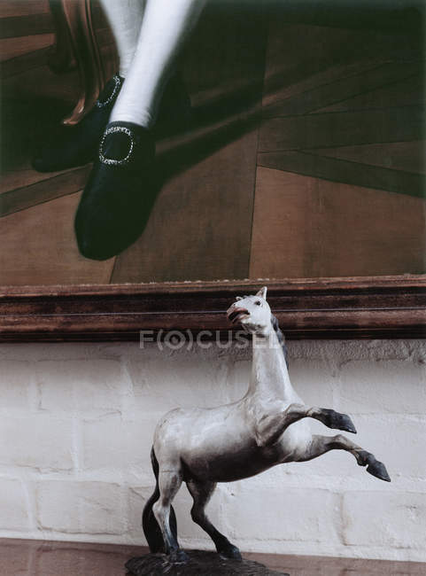 Close up view of horse figurine below painting — Stock Photo