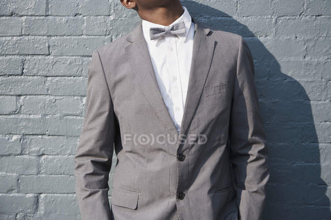 Mid section of man wearing  bow tie and suit — Stock Photo